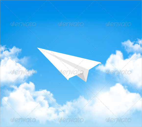 paper airplane in sky with clouds